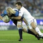 Bulls player Dewald Potgieter, left, defends against Stormers' Andries Bekker, right, during the...