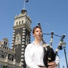 Busking performer Oliver Cathro plays the bagpipes outside the Dunedin Railway Station at 12.30pm...