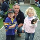 Caleb Jones (2), of Timaru, shows off the yellow-eyed mullet he caught in the Nugget Point Easter...