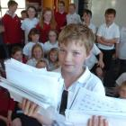 Cameron Donaldson (10) holds the results of a random bedtime survey carried out by the Otago...