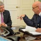 Canadian Prime Minister Stephen Harper (L) is briefed by Royal Canadian Mounted Police...