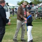 Canterbury A&P 2013 Show Legend Ivan Robertson presents junior dairy stock judge Sophie Geddes,...