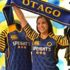 Canterbury of New Zealand Dunedin store manager Katelyn Osten wears Otago rugby apparel in...