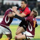 Canterbury's Sonny Bill Williams is wrapped up by the Southland defence. Credit:NZPA / Dianne...