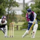 Carisbrook-Dunedin opening batsman James Hogg prods forward as Albion wicketkeeper Shaun Haig...