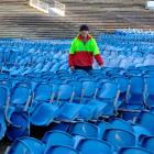 Carisbrook Rotary Project chairman Brendon Bearman stands among a stack of Carisbrook seats for...