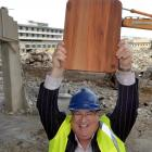 Carisbrook Rotary Project committee member Lindsay Thorburn holds a rimu chopping board at...