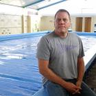 Carisbrook School principal Ben Sincock is considering keeping the school pool open for one term...