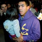 Carlos Tevez with one of his daughters in Buenos Aires earlier this month. Tevez will face...
