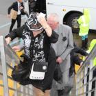 Carolynn Robertson, of Wyndham, hangs on her hat as ...