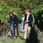 Catherine, the Duchess of Cambridge, and Prince William, the Duke of Cambridge, walk through the...