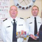 Celebrating service: Navy Otago divisional coxswain Mark Jolly (left) discusses the World War 2...