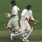 Central Districts batsmen Brad Patton (left) and Mathew Sinclair cross while taking a run on...