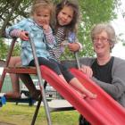Central Otago Kindergarten Association manager Angela Jacobsen is joined by Neve (3, left) and...