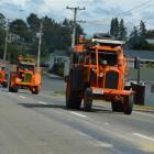 Chamberlain 9G tractors leave Tapanui on Saturday during a month-long tour of the South Island....