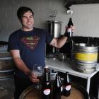Champion home-brewer Brendan Bransgrove checks the quality of his award-winning Little Jimi...