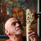 With his grandmother Huhana looking over his shoulder, Lou Armstrong studies a traditional Maori...