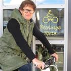 Charge About director Campbell Read with one of his eBikes at a charging station. Photo supplied.