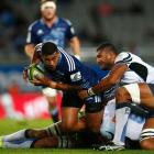 Charles Piutau is caught by the Force defence. Photo Getty Images
