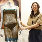 Charlotte Todd stands next to the dress she designed, and which was worn by Kate Middleton before...