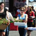 Charlotte Tonks (left) and Rhonna Hayes sell mistletoe posies at the Christmas farmers market....