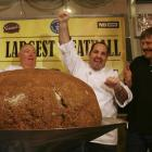 Chef Matthew Mitnitsky cheers after his meatball weighed in, breaking the world record for the...