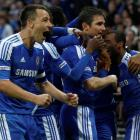 Chelsea's Frank Lampard (2nd R) celebrates with teammates after scoring during their FA Cup...