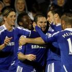 Chelsea's Frank Lampard (C) celebrates with teammates after scoring with a penalty against Fulham...