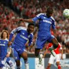 Chelsea's Ramires heads the ball in front of Benfica's Javi Garcia (R) during their Champions...