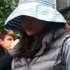 Chia-Fang Chu leaves court today after admitting causing a car crash that killed her father....