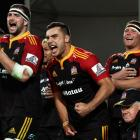 Chiefs team mates (L to R) Matt Symons, James Lowe and Mitchell Graham celebrate during the round...