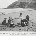 Children building a sandcastle on St Clair beach, Dunedin.  - Otago Witness, 23.3.1910.