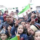Children flash victory signs during a rally against Syria's President Bashar al-Assad in Jerjenaz...