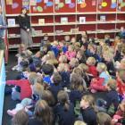 Children's author Kyle Mewburn, of Millers Flat, (left), next to principal Debbie Dickson, reads...