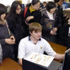 Chinese education agents (from left) Melissa Qin, Yetta Kwan, Angel Hua, and Jade Yao talk to...