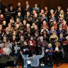 David Burchell conducts the City Choir Dunedin and Columba Junior Madrigal Choir during a rehearsal for Saturday's Knox Church concert. Photo by Craig Baxter