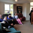 Chris and Shari Roy and their children, Riana (16) and Whakatau (12), sit in the lounge of their...