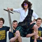 Chris Brun (25) dressed as ''Hamish'' and (from left) Gregor Croudis (21), Jon Thom (24) and...