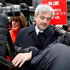 Chris Huhne, Britain's former energy secretary, is accompanied by his partner Carina Trimingham,...