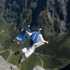 Chuck Berry base-jumps with  fellow dare-devils above   Milford Sound. Photo supplied.