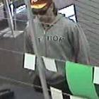 Security camera photo of the Exchange Post Shop offender.