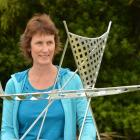 Clutha district councillor Hillary McNab inspects the model of Russell Beck's waka sculpture  the...