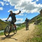 Colin MacDonald (left) and Mark Townsley, both of Queenstown, bike the Clutha Gold Trail near...