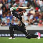 Colin Munro launches another big shot on his way to 50 off 14 balls. Photo Getty