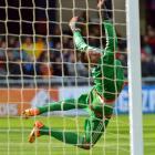 Colombian goalkeeper Alvaro Montero dives but fails to save a free kick taken by Portugal's Nuno...