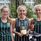 Columba College runners (from left) Charlotte Cahill, Sian English and Hanna English celebrate...