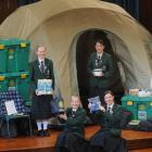Columba College school council prefects displaying items from their latest fundraising project...