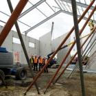 Work proceeds on the East Otago community sports and cultural centre as (from left) site foreman...