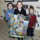Community Art at the Stadium artists (from left) Milly Elworthy (9), Holly Ford (10) and Matt...