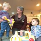 Community Karitane Madeline Lawn, of Queenstown, plays with Jasper Eckford (left) and Lucas...